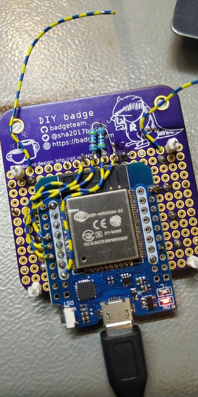 Back of the badge, with two pullup resistors floating on the header pins